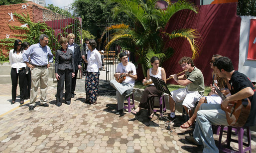 Mrs. Laura Bush listens to a musical performance at Projeto Aprendiz Friday, March 9, 2007, in Sao Paolo, Brazil. Developing the concept of the neighborhood as a school, the program supplements school education with a wide range of community-based activities. The work carried out by Aprendiz has been recognized by UNICEF as a best practice project to be disseminated worldwide. White House photo by Shealah Craighead