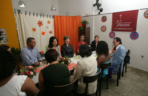 Mrs. Laura Bush talks with program participants of Projeto Aprendiz Friday, March 9, 2007, in Sao Paolo, Brazil. The organization has developed the concept of the neighborhood as a school, the program supplements school education with a wide range of community-based activities. The work carried out by Aprendiz has been recognized by UNICEF as a best practice project to be disseminated worldwide. White House photo by Shealah Craighead