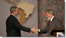 President George W. Bush and Brazil's President Luiz Inacio Lula da Silva shake hands Friday, March 9, 2007, after a joint press availability in Sao Paulo. The two leaders met for the day and discussed many topics, including biofuels, energy, and international affairs. White House photo by Paul Morse