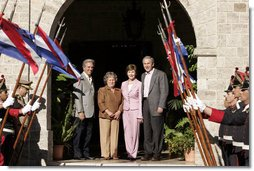 President George W. Bush and Mrs. Laura Bush stand for photos Saturday, March 10, 2007, with President Tabare Vazquez of Uruguay and his wife, Mrs. Maria Auxiliadora Delgado de Vazquez at Estancia Anchorena. The President and Mrs. Bush will overnight in nearby Montevideo before continuing on to Colombia for the fourth stop of their five-country, Latin American visit. White House photo by Paul Morse