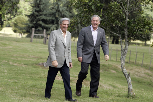 President George W. Bush and President Tabare Vazquez walk to their joint press availability Saturday, March 10, 2007, on the grounds of Estancia Anchorena, the Uruguayan President's retreat. White House photo by Paul Morse