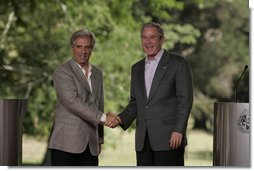 "President George W. Bush and President Tabare Vazquez shake hands after a their joint press availability Saturday, March 10, 2007, at Estancia Anchorena. President Bush pledged to work hard for a compassionate and rational immigration law ""that respects the rule of law, but also respects the great traditions of the United States, a tradition which is a welcoming society.""  White House photo by Paul Morse"