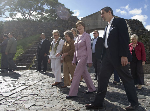 Mrs. Laura Bush joins Mrs. Maria Auxiliadora Delgado de Vazquez, in brown, wife of Uruguay's President Tabare Vazquez, during a walking tour Saturday, March 10, 2007, of the historic Portuguese settlement Colonia del Sacramento. White House photo by Shealah Craighead