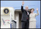 President George W. Bush and Mrs. Laura Bush wave from Air Force One Sunday, March 11, 2007. President Bush traveled from Uruguay to Bogot�, Colombia, where he was honored by an arrival ceremony at Casa de Narino. White House photo by Eric Draper