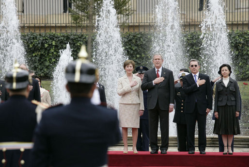 President George W. Bush and Mrs. Laura Bush participate in an arrival ceremony with Colombian President Alvaro Uribe and his wife Lina Moreno at Casa de Narino in Bogotá, Colombia, Sunday, March 11, 2007. White House photo by Eric Draper