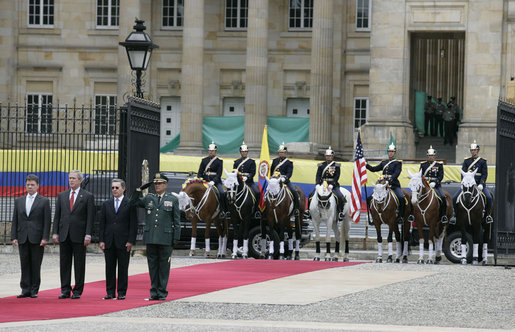 President George W. Bush stands at attention during an arrival ceremony with Colombian President Alvaro Uribe at Casa de Narino in Bogotá, Colombia, Sunday, March 11, 2007. White House photo by Eric Draper