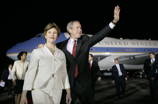 President George W. Bush and Mrs. Laura Bush wave to the crowd on hand for their arrival Sunday, March 12, 2007, at La Aurora Air Force Base in Guatemala City. Guatemala is the fourth stop in their five-country, Latin American visit. White House photo by Eric Draper