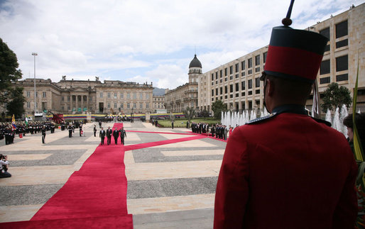 President George W. Bush stands at attention during an arrival ceremony with Colombian President Alvaro Uribe at Casa de Narino in Bogotá, Colombia, Sunday, March 11, 2007. White House photo by Paul Morse