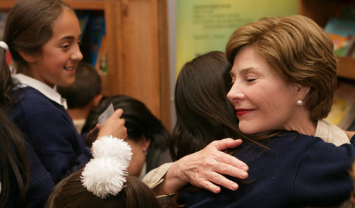 Mrs. Laura Bush hugs a student during her a visit to Rafael Pombo Foundation Sunday, March 11, 2007, in Bogota, Colombia. White House photo by Shealah Craighead