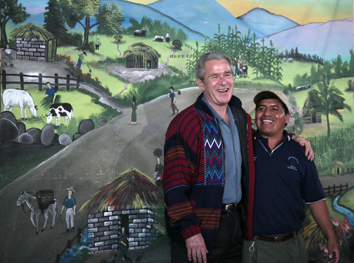 President George W. Bush meets with an employee Monday, March 12, 2007, at the Labradores Mayas Packing Station in Chirijuyu, Guatemala. The President and Mrs. Laura Bush are on the fourth leg of a five-country trip through Central and South America. They are scheduled to arrive in Mexico later in the day. White House photo by Paul Morse