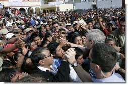 Hundreds of villagers greet President George W. Bush and Mrs. Laura Bush Monday, March 12, 2007, during their visit to Santa Cruz Balanya, Guatemala.  White House photo by Eric Draper