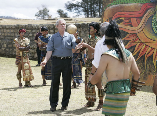 President George W. Bush tests his skills as he joins athletes in a Mayan Ritual Competition during a tour Monday, March 12, 2007, to Iximche, Guatemala. White House photo by Eric Draper
