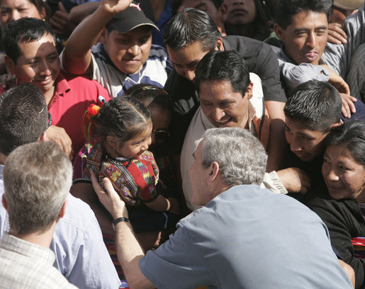 President George W. Bush reaches for a young Guatemalan child during his visit Monday, March 12, 2007, to Santa Cruz Balanya. The President and Mrs. Bush visited three Guatemala villages Monday morning before traveling to Mexico. White House photo by Paul Morse
