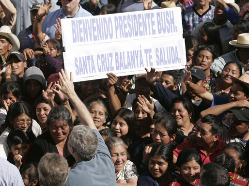 A sign welcoming President George W. Bush is held up by the crowd as the President waves upon his arrival Monday, March 12, 2007, to the Town Square of Santa Cruz Balanya, Guatemala. The President and Mrs. Laura Bush spent the morning in the town and other nearby towns before heading on to Mexico in the final leg of their five-country to Central and South America visit. White House photo by Paul Morse