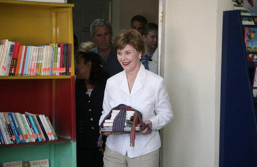 Mrs. Laura Bush holds a gift of books for the Dr. Richard Carroll Municipal Library during a tour of the facility Monday, March 12, 2007, in Santa Cruz Balanya, Guatemala. White House photo by Paul Morse