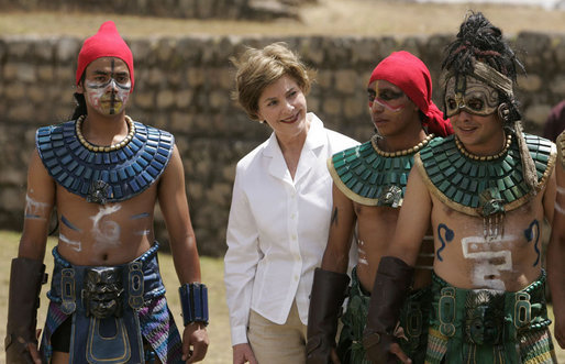 Mrs. Laura Bush poses with performers Monday, March 12, 2007, after a demonstration of a Mayan Ritual competition in Iximche, Guatemala. President and Mrs. Bush visited three Guatemalan villages during the morning hours before departing for Mexico, the last stop of their five-country, Latin American visit. White House photo by Paul Morse