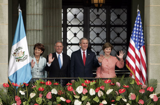 President George W. Bush and Mrs. Laura Bush and President Oscar Berger of Guatemala, and Mrs. Wendy Widmann de Berger wave to the audience Monday, March 12, 2007, during the arrival ceremonies at the Palacio Nacional de la Cultura in Guatemala City. White House photo by Paul Morse
