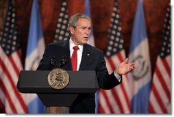 President George W. Bush delivers a point during a joint press availability Monday, March 12, 2007, with Guatemalan President Oscar Berger at the Palacio Nacional de la Cultura in Guatemala City. The President and Mrs. Bush joined the Bergers for dinner before departing Monday evening for Mexico. White House photo by Paul Morse