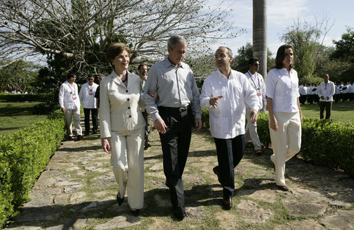 President George W. Bush and Mrs. Laura Bush walk with Mexico's President Felipe Calderon and Mrs. Margarita Zavala upon their arrival Tuesday, March 13, 2007, to Hacienda Temozon in Temozon Sur, Mexico. White House photo by Eric Draper