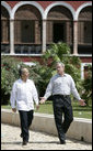 President George W. Bush and Mexico's President Felipe Calderon walk along a path Tuesday, March 13, 2007, en route to a meeting at the Hacienda Temozon in Temozon Sur, Mexico. The visit to the area marked the final leg of the President's five-country Latin American tour. White House photo by Eric Draper