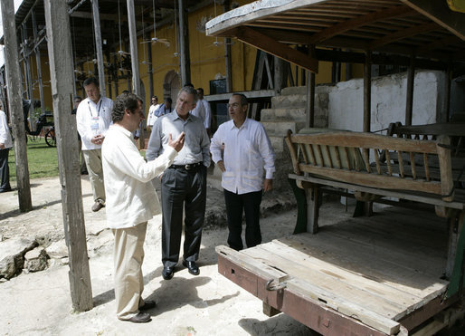 President George W. Bush and President Felipe Calderon of Mexico, right, are given a history of the Hacienda Temozon Tuesday, March 13, 2007, during a visit by the President and Mrs. Laura Bush. White House photo by Eric Draper