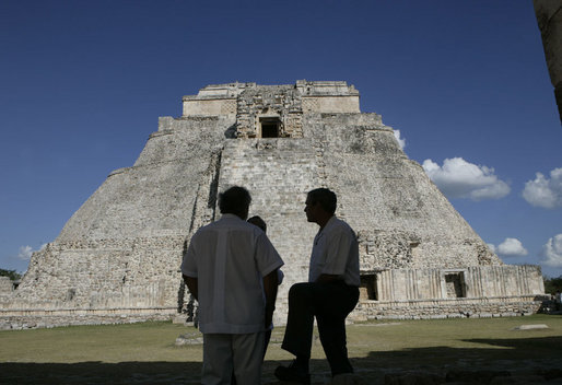 President George W. Bush is silhouetted as he pauses with President Felipe Calderon of Mexico and an interpreter during their tour Tuesday, March 13, 2007, of the Mayan ruins of Uxmal. White House photo by Eric Draper