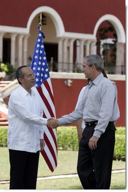 "President George W. Bush exchanges handshakes with Felipe Calderon, President of Mexico, during the arrival ceremonies Tuesday, March 13, 2007, welcoming the President and Mrs. Bush to the country. President Calderon told the President, ""Mr. President, I have no doubt that together our governments will move forward in the generation of new opportunities of well-being and prosperity for our nations. Please feel very, very welcome to Mexico."" White House photo by Paul Morse"