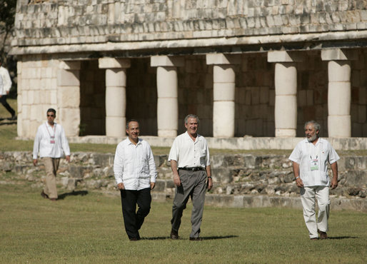 President George W. Bush and President Felipe Calderon walk amid the Mayan ruins of Uxmal Tuesday, March 13, 2007, during the visit by the President and Mrs. Laura Bush to Mexico. White House photo by Paul Morse