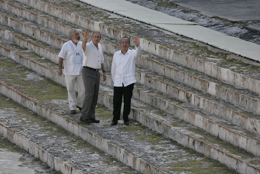 President George W. Bush and Mexico's President Felipe Calderon wave from the steps of the Uxmal Mayan ruins Tuesday, March 13, 2007. White House photo by Paul Morse
