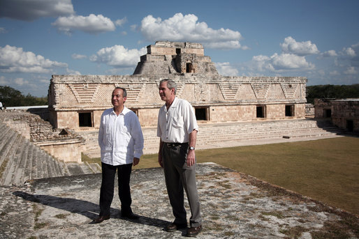 President George W. Bush and President Felipe Calderon of Mexico pause during a tour Tuesday, March 13, 2007, of the Uxmal, one of the most famous of the Mayan ruins. The President and Mrs. Laura Bush capped their five-day, Latin American visit with the stop in Mexico. White House photo by Paul Morse