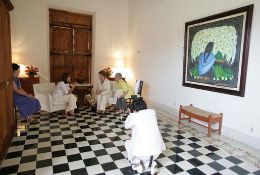 A photographer records a meeting between Mrs. Laura Bush and Mrs. Margarita Zavala, wife of Mexico President Felipe Calderon, during their visit Tuesday, March 13, 2007, in Temozon Sur, Mexico. White House photo by Shealah Craighead