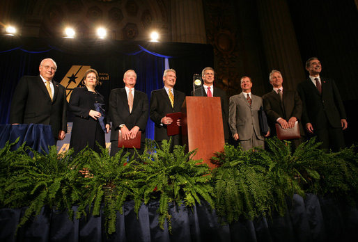 Vice President Dick Cheney, far left, stands with Secretary of Commerce Carlos Gutierrez, far right, and the 2006 Malcolm Baldrige National Quality Award recipients, Tuesday, March 13, 2007 during the 2006 Malcolm Baldrige National Quality Award Ceremony in Washington, D.C. From left the recipients are Kelli Loftin Price and Richard Norling of Premier Inc., San Diego, Calif.; Charles D. Stokes and John Heer of North Mississippi Medical Center of Tupelo, Miss.; John Cole and Terry F. May of MESA Products, Inc., Tulsa, Okla. White House photo by David Bohrer