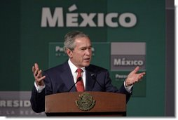 President George W. Bush addresses a reporter's question Wednesday, March 14, 2007 in Merida, Mexico, during a joint news conference with Mexico's President Felipe Calderon.  White House photo by Paul Morse