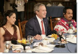 President George W. Bush participants in a breakfast meeting with Training, Internships and Scholarships (TIES) recipients Wednesday, March 14, 2007, in Merida, Mexico.  White House photo by Eric Draper