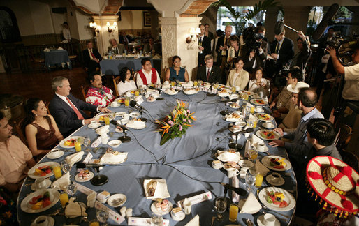 President George W. Bush joins a breakfast meeting with Training, Internships and Scholarships (TIES) recipients Wednesday, March 14, 2007, in Merida, Mexico. White House photo by Eric Draper