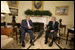 "President George W. Bush talks with Iraqi Vice President Adil Abd Al-Mahdi, Thursday, March 15, 2007, during a meeting with the press in the Oval Office. ""You, Mr. Vice President, are showing strong vision, and a vision of peace and reconciliation,"" said President Bush, adding, ""And I welcome you to the Oval Office. I thank you for your courage, and I thank you for the conversation we've had."" White House photo by Eric Draper"