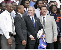 President George W. Bush is joined by University of Florida Gators football coach Urban Meyers, right, and team quarterback Chris Leak during ceremonies at the White House, Monday, March 19, 2007, to honor the 2006 NCAA football championship team. White House photo by Eric Draper