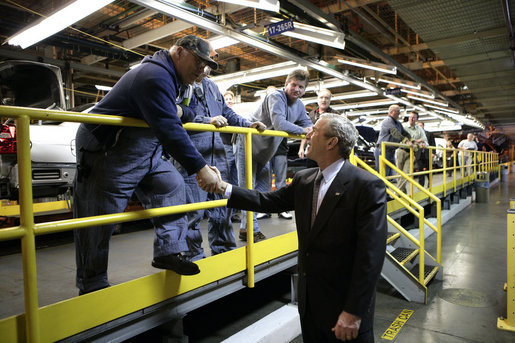 President George W. Bush shakes the hand of an employee at the General Motors Fairfax Assembly Plant Tuesday, March 20, 2007, in Fairfax, Kansas. White House photo by Eric Draper