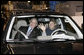 President George W. Bush sits in a hybrid Ford Escape with Barbara Neal, an employee of the Ford Motor Company - Kansas City Assembly Plant in Claycomo, Missouri Tuesday, March 20, 2007. The President took the opportunity to deliver remarks on Energy Initiatives during the Midwest stop. White House photo by Eric Draper