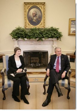 President George W. Bush and Prime Minister Helen Clark of New Zealand talk to reporters during their meeting in the Oval Office Wednesday, March 21, 2007. White House photo by Eric Draper