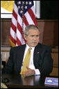 "President George W. Bush takes part in a roundtable with Iraq provincial reconstruction team leaders in the Dwight D. Eisenhower Executive Office Building Thursday, March 22, 2007. ""We don't want you to go into Iraq and then have unnecessary strings placed upon the money so you can't do your job,"" said the President to the press. ""Congress needs to get their business done quickly, get the monies we've requested funded, and let our folks on the ground do the job."" White House photo by Joyce Boghosian"