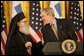 President George W. Bush smiles as he welcomes His Eminence Archbishop Demetrios to the White House Friday, March 23, 2007, to celebrate Greek Independence Day and to recognize the contributions of Greek-Americans to American culture. This year's ceremony also recognized the 40th anniversary of the episcopacy of the Archbishop. White House photo by Eric Draper