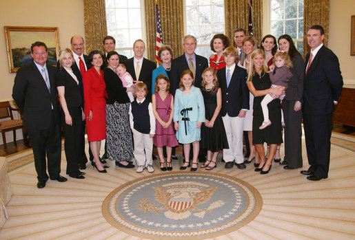 President George W. Bush and Mrs. Laura Bush pose for a photo with the family of former President Lyndon Baines Johnson in the Oval Office, Friday, March 23, 2007, following the signing of H.R. 584 designating the U.S. Department of Education in Washington, D.C., as the Lyndon Baines Johnson Federal Building. White House photo by Eric Draper