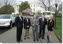 President George W. Bush talks to the media after a demonstration Monday, March 26, 2007, of alternative fuel vehicles on the South Lawn drive of the White House. Standing with him from left, are: Rick Wagoner, Chairman and CEO, General Motors Corporation; Alan Mulally, President and CEO, Ford Motor Company; Tom LaSorda, President and CEO, DaimlerChrysler Corporation, and Secretary of Transportation Mary Peters. White House photo by Joyce Boghosian