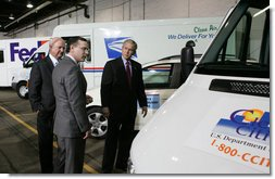 President George W. Bush and Secretary of Energy Sam Bodman listen to Mark Chernoby as the Vice President of Advance Vehicle Engineering at DaimlerChrysler describes the FedEx Pilot Program Plug-in Hybrid Sprinter during the President's visit Tuesday, March 27, 2007, to the U.S. Postal Service Vehicle Maintenance Facility in Washington, D.C. White House photo by Joyce N. Boghosian