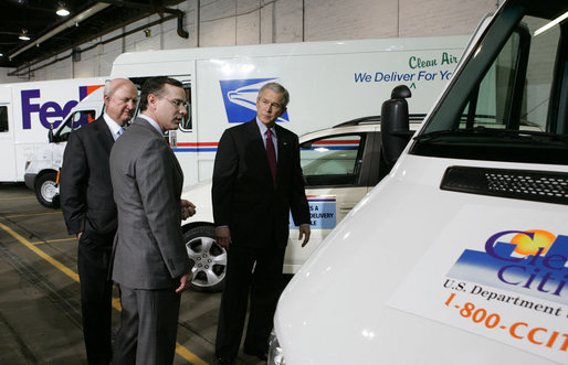 President George W. Bush and Secretary of Energy Sam Bodman listen to Mark Chernoby as the Vice President of Advance Vehicle Engineering at DaimlerChrysler describes the FedEx Pilot Program Plug-in Hybrid Sprinter during the President's visit Tuesday, March 27, 2007, to the U.S. Postal Service Vehicle Maintenance Facility in Washington, D.C. White House photo by Joyce Boghosian