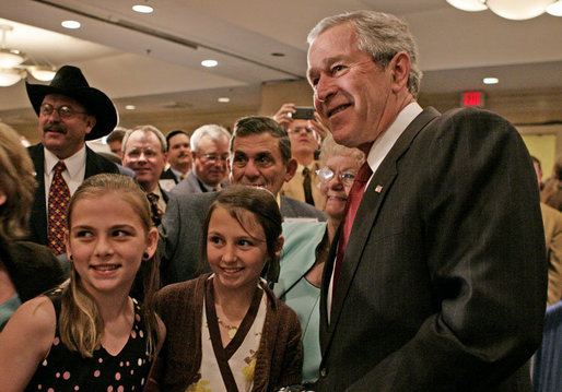 President George W. Bush poses for photos and meets guests following his remarks to the National Cattlemen's Beef Association Wednesday, March 28, 2007 in Washington, D.C. White House photo by Joyce Boghosian