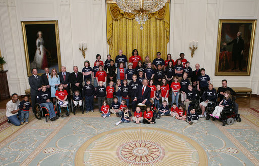 President George W. Bush poses with the Children's Miracle Network Champions and leadership members in the East Room of the White House, Thursday, March 29, 2007, honoring the CMN organization for their work in helping save and improve the lives of children with severe medical challenges. White House photo by Eric Draper
