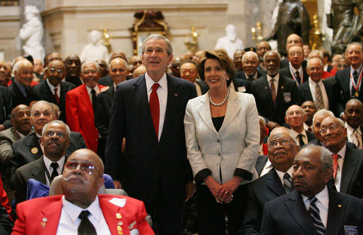 President George W. Bush and Speaker of the House Nancy Pelosi join 300 Tuskegee Airmen in Statuary Hall at the U.S. Capitol for a photograph Thursday, March 29, 2007. The group photo was part of the Congressional Gold Medal ceremony honoring America's first African-American military airmen. White House photo by Eric Draper