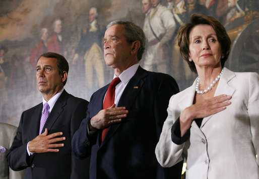 President George W. Bush stands with House Minority Leader John Boehner and Speaker of the House Nancy Pelosi for the playing of the National Anthem Thursday, March 29, 2007, during Congressional Gold Medal ceremonies honoring the Tuskegee Airmen. White House photo by Eric Draper